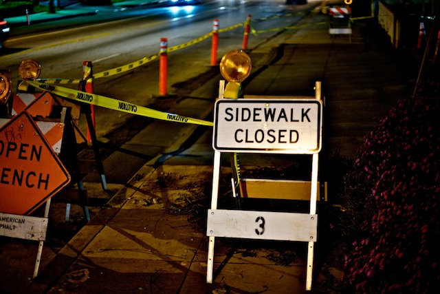 Caltrans says screw wheel chair access or posting pedestrian detours ahead of time.